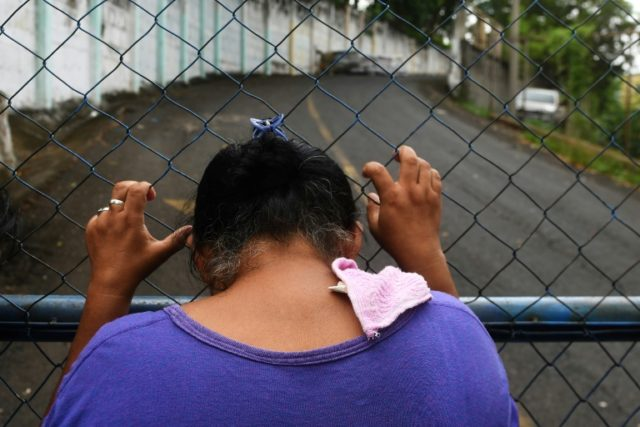"A mother demands the release of her son captured by police and paramilitaries and held at ""El Chipote"" prison in Managua, on June 16, 2018"