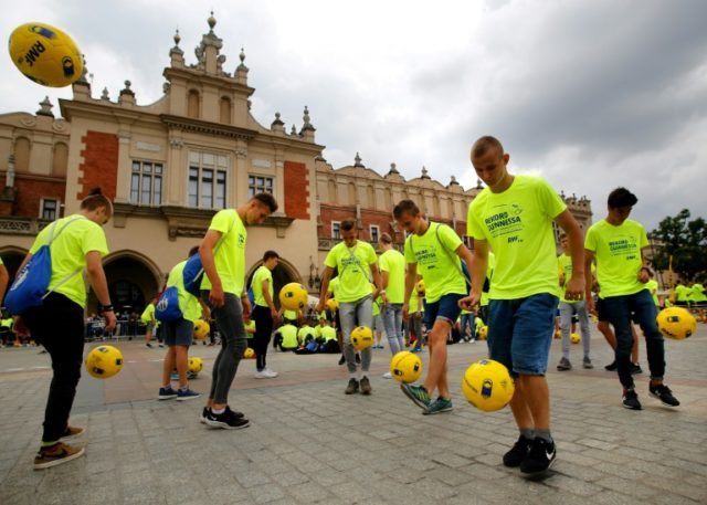 1,444 Polish football fans dressed in neon yellow to break the world record