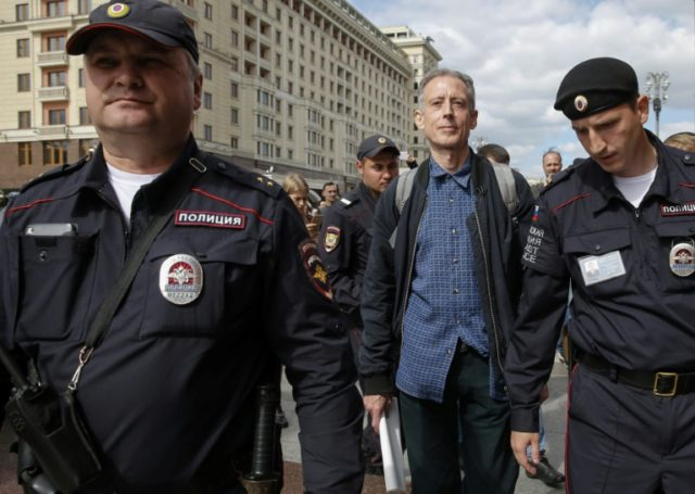 British gay rights activist Peter Tatchell was arrested after staging a one-man protest in Moscow