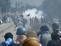 Kashmiri youths throw stones during clashes in Srinagar on June 16