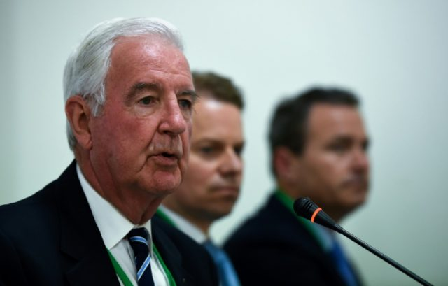 Head of the World Anti-Doping Agency (WADA), Craig Reedie (L), speaks during a press conference at the start of a two-day ministerial meeting on tackling doping in sport