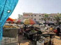 A picture taken on June 6, 2018, shows people shopping at a market in the northern Syrian town of Manbij