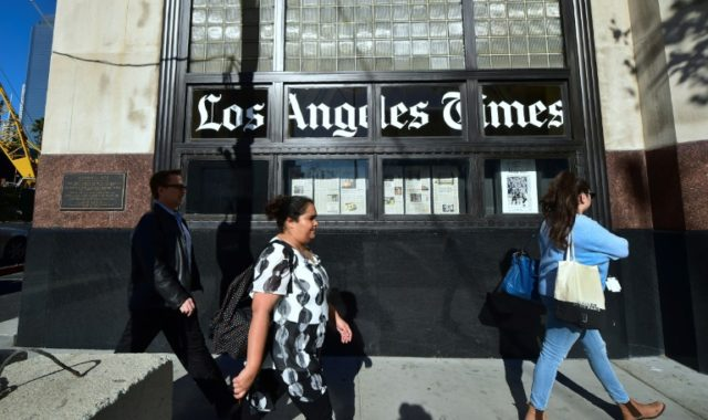 Patrick Soon-Shiong finalized a deal to take over the Los Angeles Times Monday and named as executive editor veteran journalist Norman Pearlstine
