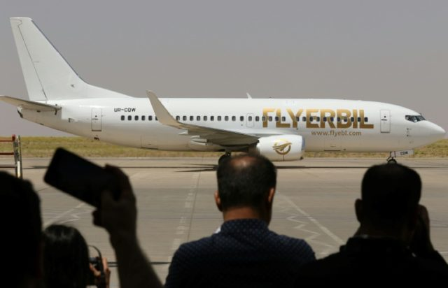 People watch a Fly Erbil aircraft as it prepares to take off for a flight to Stockholm from Arbil International Airport in the capital of the Kurdish autonomous region in northern Iraq, on June 18, 2018