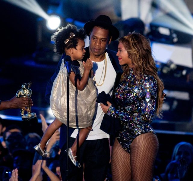"""Rapper Jay-Z and singer Beyonce, pictured in 2014 with their daughter Blue Ivy Carter, marry their two musical styles on a surprise joint album, """"Everything is Love"""""""