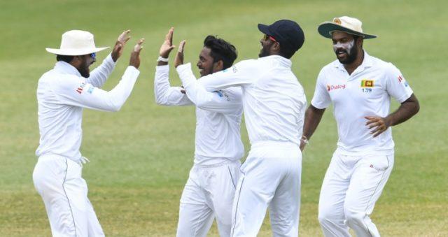 Akila Dananjaya (2L) Dinesh Chandimal (L) and Lahiru Kumara (R) of Sri Lanka celebrate the dismissal of Shane Dowrich of West Indies during day 5 of the 2nd Test between West Indies and Sri Lanka at Daren Sammy Cricket Ground, Gros Islet, St. Lucia