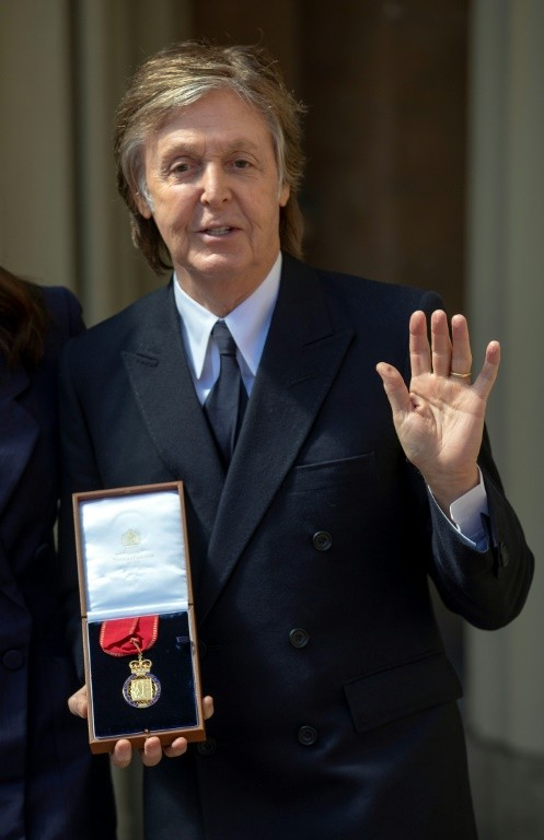 British musician Paul McCartney -- seen here after an investiture ceremony at Buckingham Palace in London where was made a Companion of Honour on May 4, 2018 -- hints at new album release