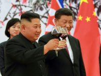 North Korean leader Kim Jong Un and Chinese President Xi Jinping make a toast at the Great Hall of the People in Beijing