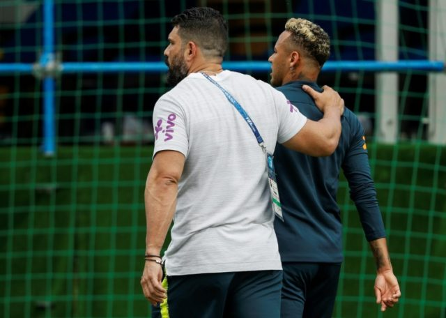 Neymar leaves Brazil's training session with team physio Bruno Mazziotti