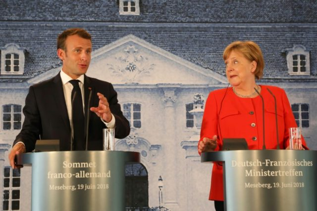 "French President Emmanuel Macron (L) and German Chancellor Angela Merkel seek a joint European effort to hammer out reforms that can stop the ""disintegration"" of the European Union"