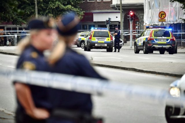 Police cordon off an area after five people were shot and injured in central Malmo, Sweden