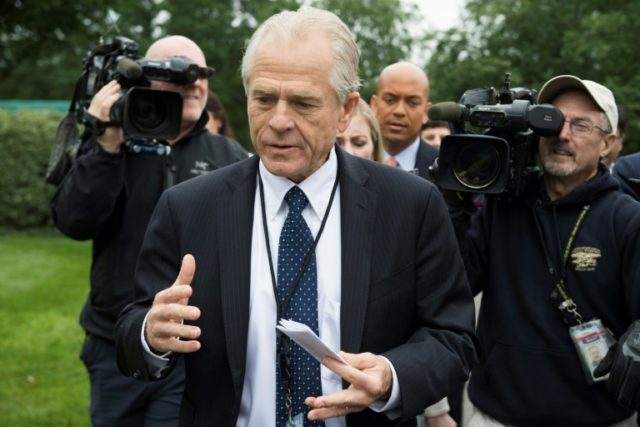 "White House Director of Trade Policy Peter Navarro (C), seen here on June 4, 2018, said the administration's policies would ""defend the crown jewels of American technology from China's aggresive behavior"""