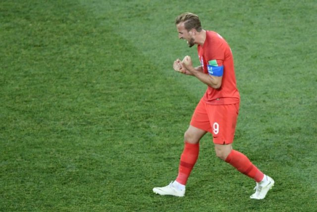 Harry Kane celebrates after England won their World Cup opener against Tunisia