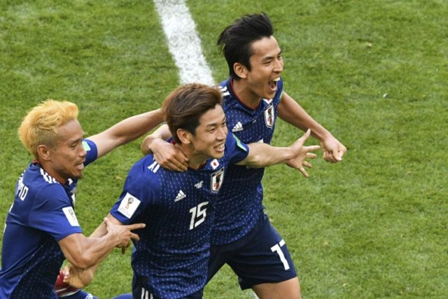 Japan forward Yuya Osako (centre) celebrates after scoring the winning goal against Colombia