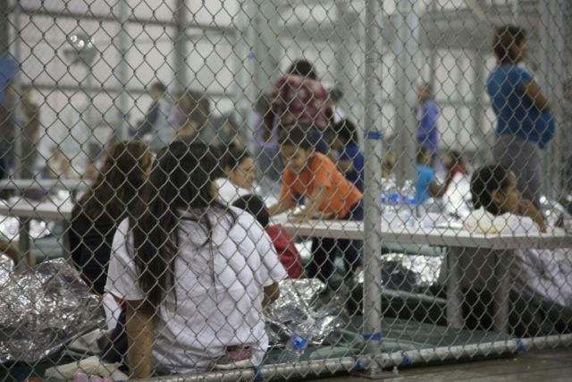 Four US states have refused to deploy National Guard troops to the Mexico border to protest the Trump administration policy of separating children of illegal migrants from their parents -- here, illegal border crossers are shown at a Texas facility