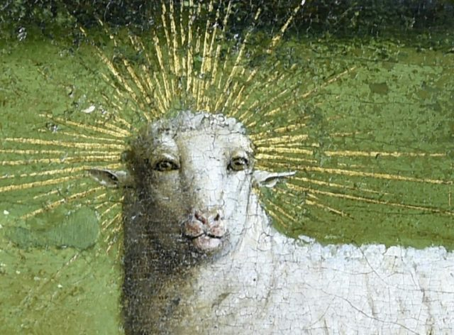"""Restorers working on the """"Mystic Lamb"""", a 15th-century masterpiece by the Van Eyck brothers, said they had uncovered a """"much more intense and expressive"""" version of the original"""