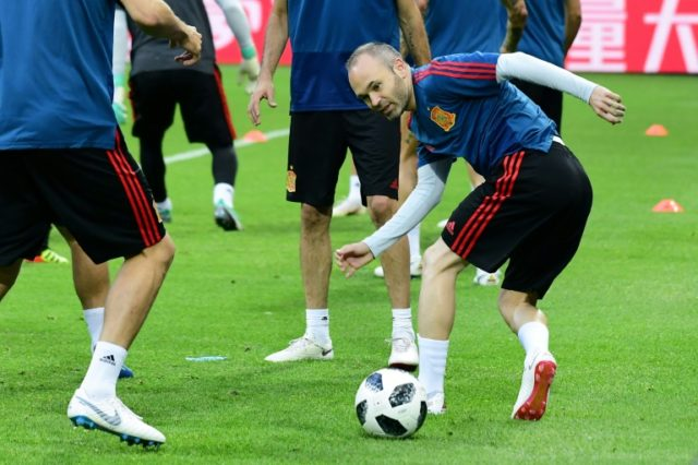 Spain's midfielder Andres Iniesta predicts victory over Iran
