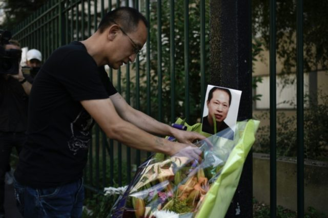 Flowers were placed with a photo of Zhang Chaolin at a building in Aubervilliers, north of Paris, last August on the anniversary of his death
