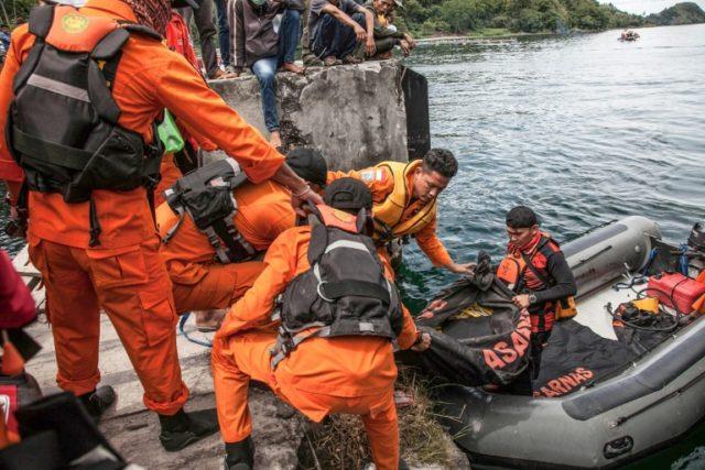 Search teams continue to hunt for bodies in Indonesia's Lake Toba - which is up to 500 metres deep in places - as authorities detained the captain of the overloaded ferry that sank Monday