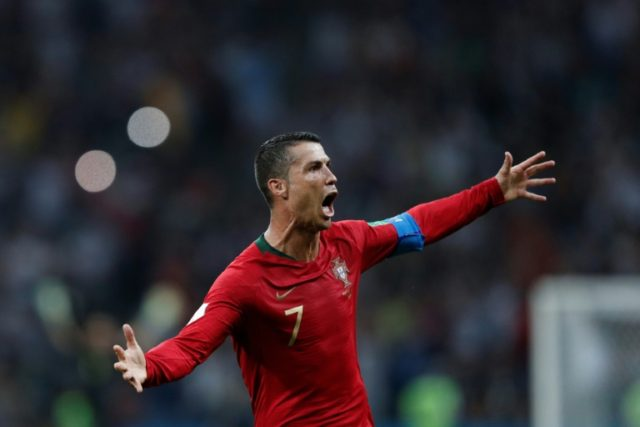 Portugal's Cristiano Ronaldo celebrates his World Cup hat-trick against Spain