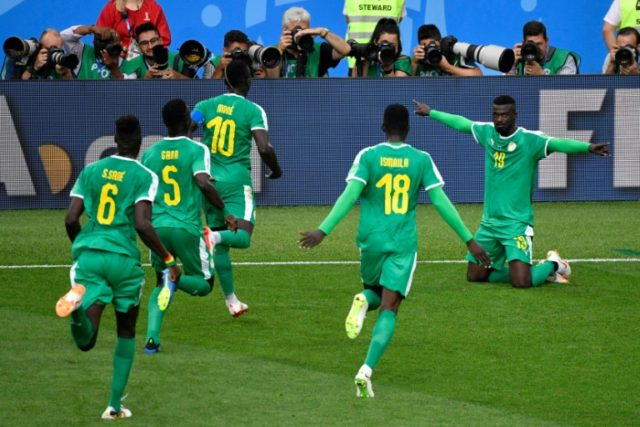 Senegal players go to celebrate with Mbaye Niang after he got what proved to be their winner against Poland