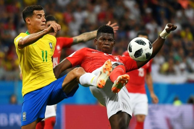 Philippe Coutinho battling for possession in Brazil's opening World Cup game against Switzerland