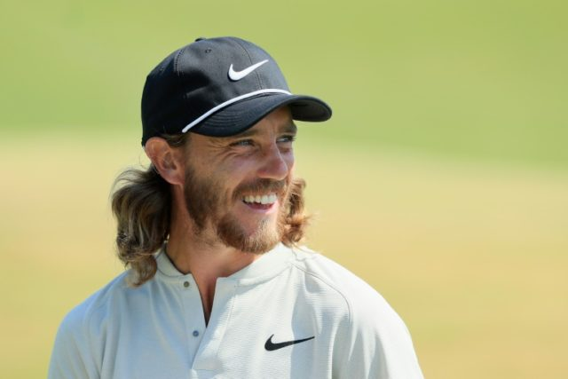 Tommy Fleetwood of England smiles after making a birdie putt on the 15th green during the final round of the 2018 US Open