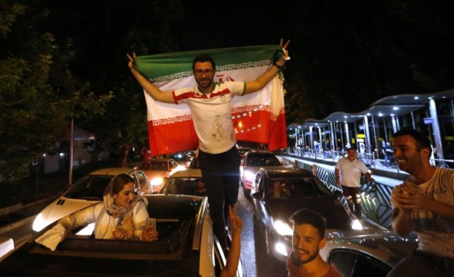 Fans celebrate in the streets of Tehran after Iran beat Morocco 1-0 in its opening World Cup game on June 15, 2018, taking it top of Group B