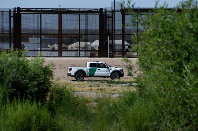 A US Border Patrol agent patrols the bed of the Rio Grand June 19, 2018 in front of where the US Customs and Boarder Protection is housing underage people caught illegally entering the United States at the Tornillo Port of Entry on the US border with Mexico
