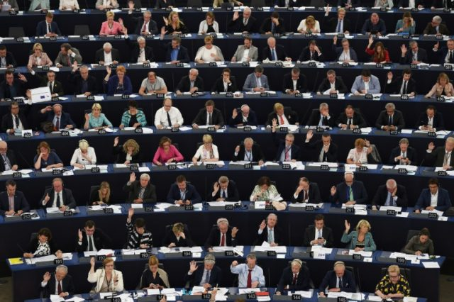 A key European parliament committee has narrowly passed a highly disputed European copyright law that could force online platforms such as Google and Facebook to pay for links to news content