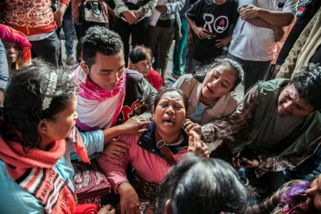 Relatives break down as they anxiously wait for news of their loved ones following the Lake Toba ferry disaster