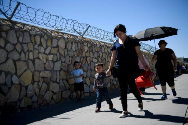 Travelers from Mexico cross a bridge leading into El Paso, Texas