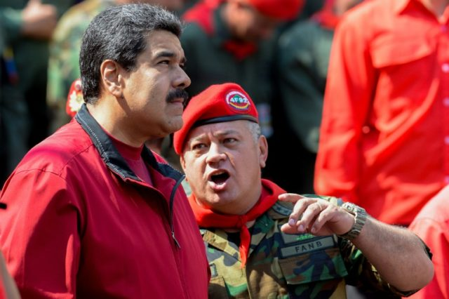 The UN has accused Venezuelan President Nicolas Maduro (L) of systematically failing to probe security officers over the alleged killings of civilians