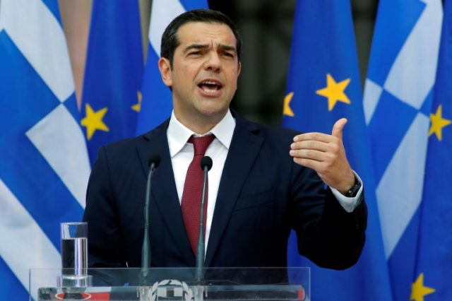 Greece's Alexis Tsipras wearing a tie for the first time since he became prime minister in 2015, after pledging we would only don one once Greece was out of debt