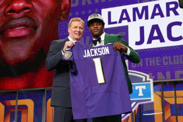 Lamar Jackson, pictured with NFL Commissioner Roger Goodell at the draft in April 2018, will report to the Baltimore Ravens camp on July 11, the earliest arrival date for any players among the league's 32 clubs