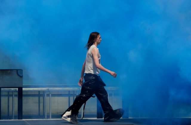Estonian rapper Tommy Cash on the catwalk for an outdoor fashion show in Paris by Rick Owens