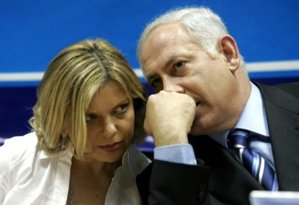 "Israeli Prime Minister Benjamin Netanyahu, seen here in a March 8, 2006 picture with his wife Sara, has said fraud charges against her are ""absurd"""