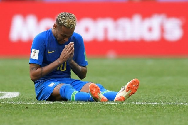 Neymar prays after Brazil beat Costa Rica 2-0 in their World Cup match in Saint Petersburg