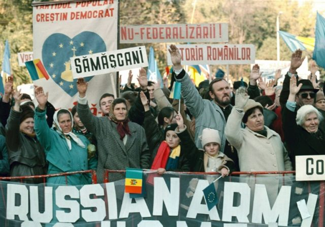 "Moldovan people protest in front of a banner reading ""Russian army go home,"" in the capital Chisinau in 2003"