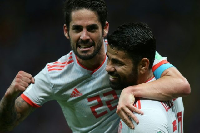 Spain's Diego Costa (R) celebrates his goal with teammate Isco during their Russia 2018 World Cup Group B match against Iran, in Kazan, on June 20
