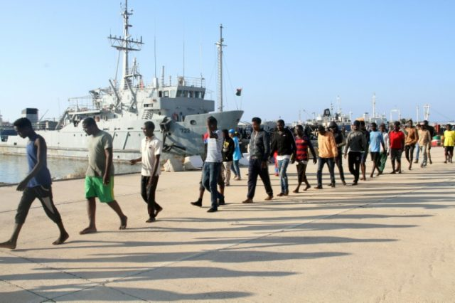 African migrants rescued by the Libyan coast guard arrive at a naval base in Tripoli on June 21, 2018