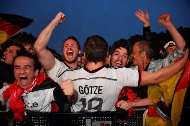 Fans dance in Berlin rain as Germany survive