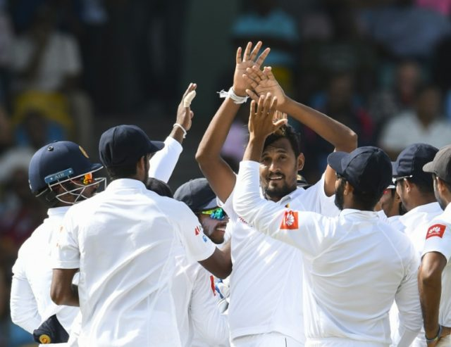 Leading from the front: Suranga Lakmal celebrates the dismissal of Devon Smith
