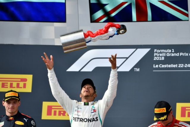 Prize guy: Lewis Hamilton celebrates on the podium