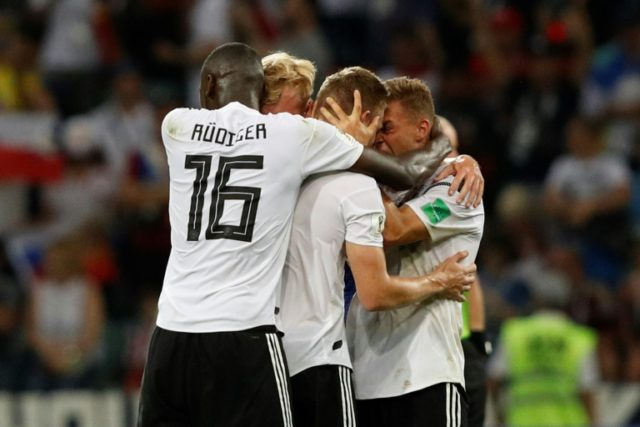 Relieved German players celebrate after Toni Kroos's winner against Sweden