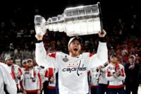 The Washington Capitals re-signed John Carlson to an eight year, $64 million contract on Sunday