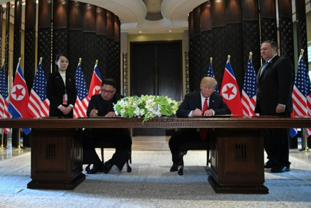 """After flying back to Washington last week, seemingly giddy with success, US President Donald Trump (r) tweeted """"There is no longer a Nuclear Threat from North Korea"""" -- a bold claim with Kim Jong Un's arsenal still in place"""
