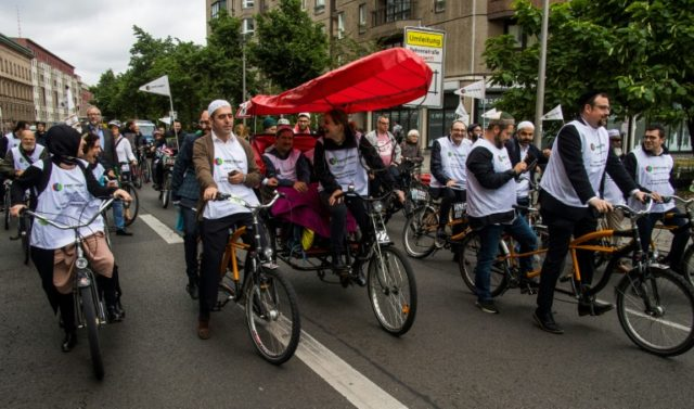 Rabbis and immams ride tandem bicycles through Berlin in an inter-faith deomionstration against racism and anti-semitism