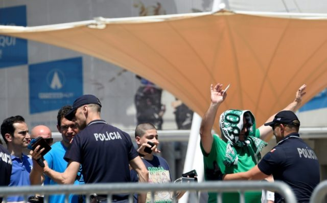 Sporting Lisbon fans frisked by police as they arrive at Saturday's AGM to vote for the crisis-club president's resignation