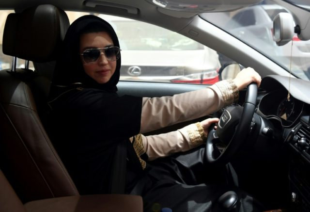 A Saudi woman behind the wheel after the lifting of the ban on women driving, with Renault marking the occasion at the French Grand Prix
